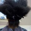 Flatiron process, but client will wear her hair curly and have a more manageable hair.